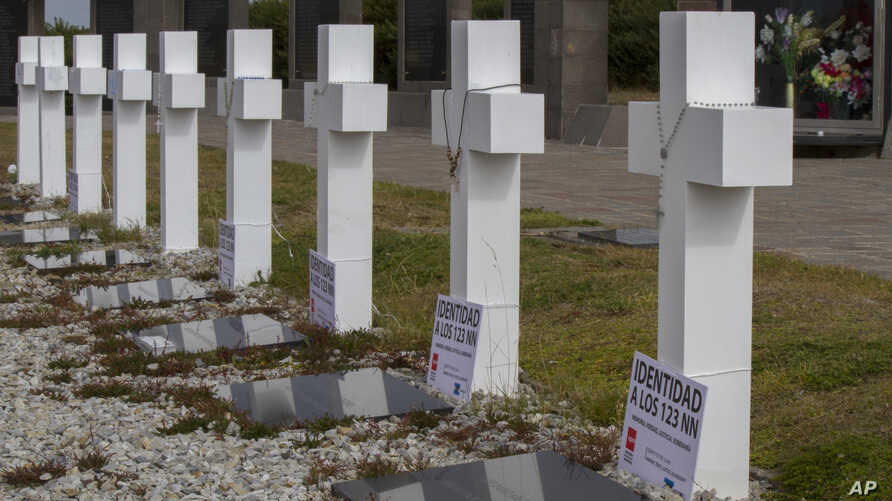 Crosses stand marking the graves of fallen soldiers at the Argentine memorial cemetery containing the remains of Argentine combatants killed during the 1982 war between Argentina and Britain, in Darwin, on Falkland Islands, Tuesday, March 14, 2017.