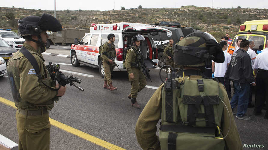 Medics evacuate an injured girl from the scene where a Palestinian attacked civilians with a chemical substance near the West Bank Jewish settlement of Neve Daniel, part of the Gush Etzion bloc, Dec. 12, 2014.