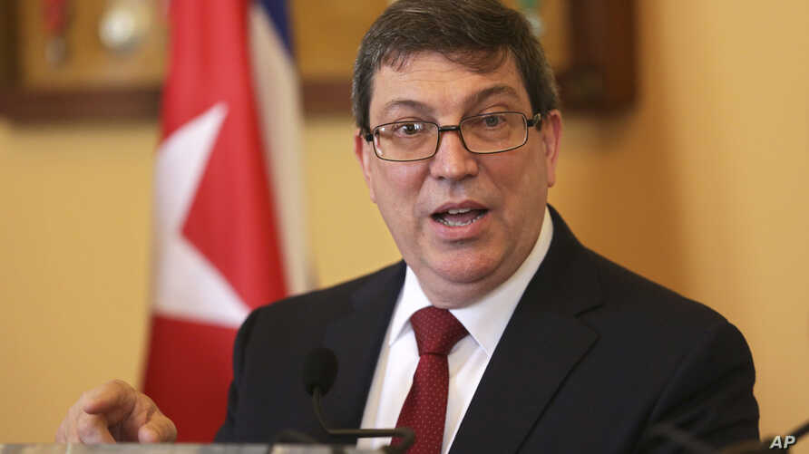 Cuba Foreign Minister Bruno Rodrigues Parrilla gestures during a news conference following his meeting with his Portuguese counterpart Augusto Santos Silva at Lisbon's Necessidades palace Wednesday, April 19, 2017.