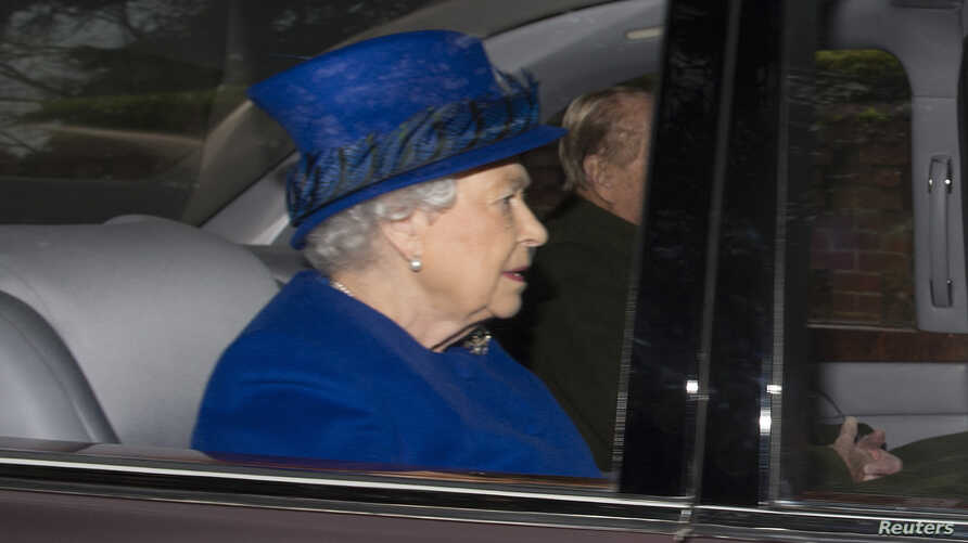 Britain's Queen Elizabeth and her husband Prince Philip arrive to attend a service at St. Mary Magdalene church in Sandringham, Jan. 8, 2017.