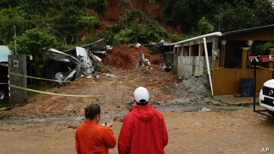 Civil Defense workers look the area where a couple was killed after their home was destroyed by a mudslide in Arraijan on the outskirts of Panama City, Tuesday, Nov. 22, 2016. Civil defense officials in Panama say the country has already seen three d