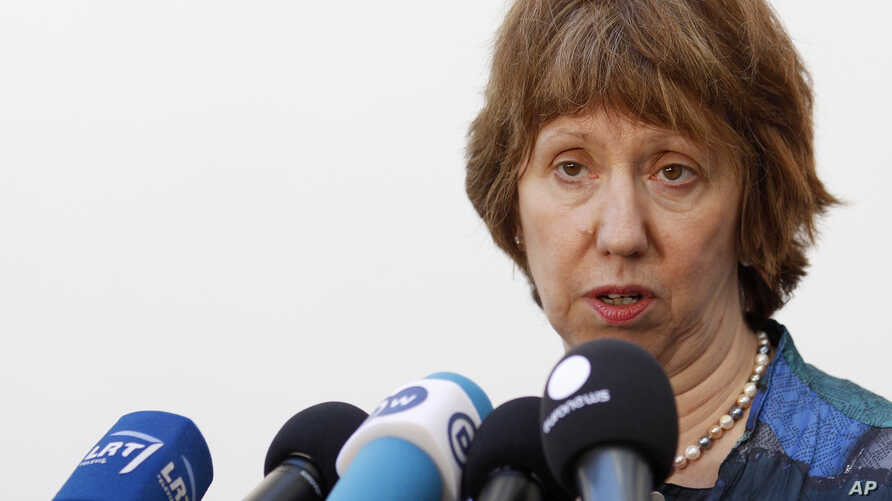 European foreign policy chief Catherine Ashton talks with journalists as she arrives for a  Informal Meeting of EU Ministers for Foreign Affairs in Vilnius, Lithuania, Sept. 6, 2013.