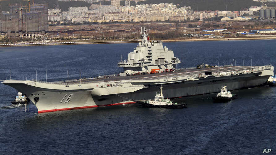 Chinese aircraft carrier Liaoning cruises back to a port after its first navy sea trial in Dalian, in northeastern China's Liaoning province, October 30, 2012.