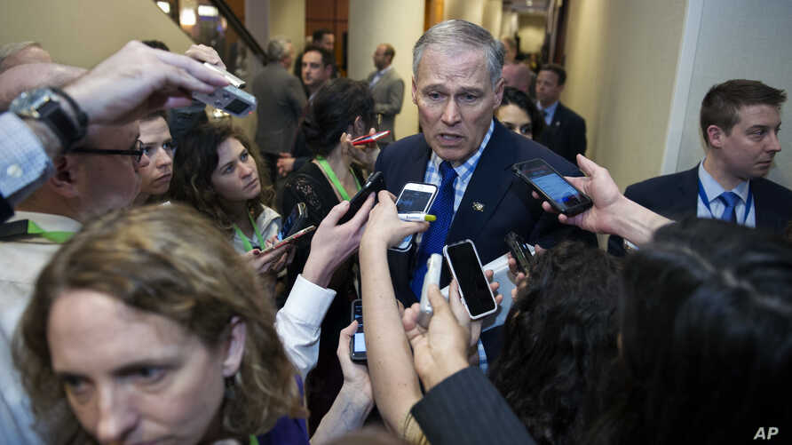 Democratic Governors Association (DGA) Vice Chairman Gov. Jay Inslee of Washington state, speaks with reporters after leaving a health care reform meeting during the National Governors Association Winter Meeting in Washington, Feb. 25, 2017.