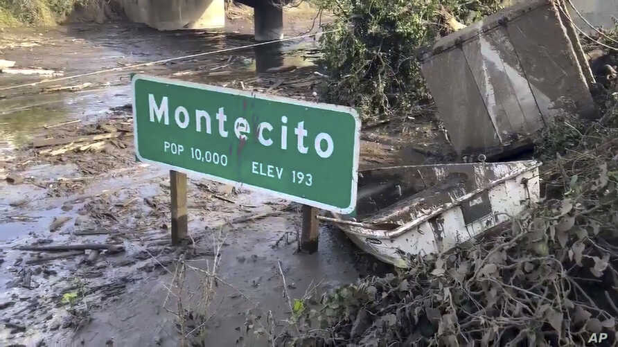 U.S. 101 highway remains underwater as cleanup crews work to clear the roads throughout Montecito, Calif., Jan. 15, 2018, following the deadly mudflow and flooding Jan. 9. California officials weren't sure Monday when the key coastal highway might re