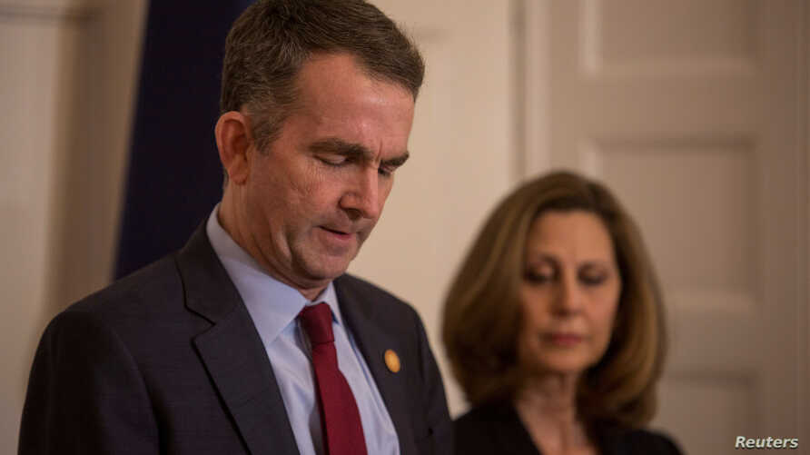 FILE - Virginia Governor Ralph Northam, accompanied by his wife Pamela Northam, speaks during a news conference in Richmond, Virginia, Feb. 2, 2019.