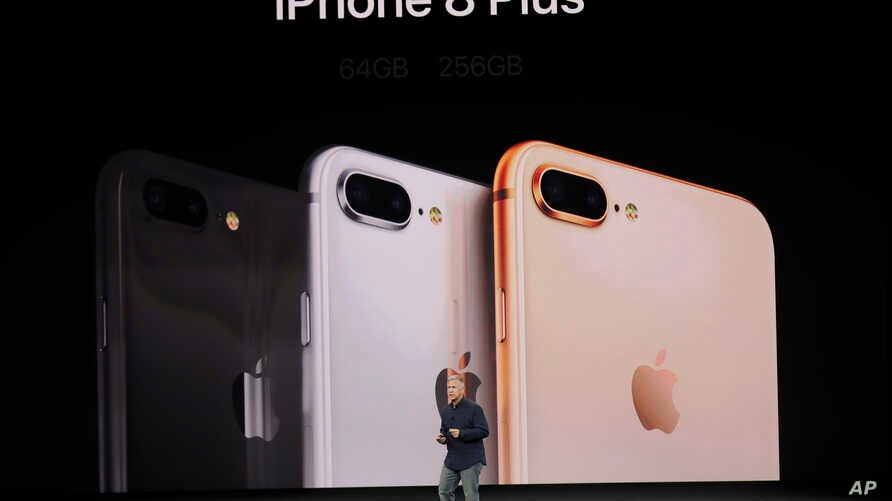 Phil Schiller, Apple's senior vice president of worldwide marketing, announces features of the new iPhone 8 at the Steve Jobs Theater on the new Apple campus on Sept. 12, 2017, in Cupertino, Calif.
