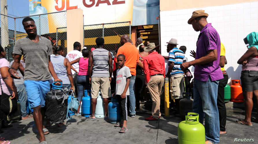 People gather while waiting to buy gas in Port-au-Prince, Haiti, Feb. 16, 2019.