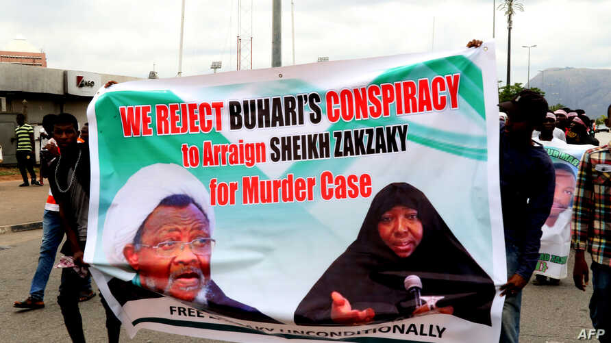 FILE - Supporters march with a banner to press for the release of Nigerian Shiite Muslim cleric Ibrahim Zakzaky on May 14, 2018 in Abuja.