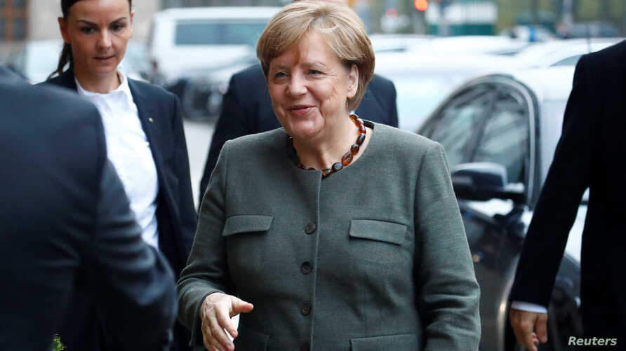 Angela Merkel, leader of the Christian Democratic Union (CDU), arrives at the German Parliamentary Society offices before the start of exploratory talks about forming a new coalition government in Berlin, Germany, Nov. 10, 2017.