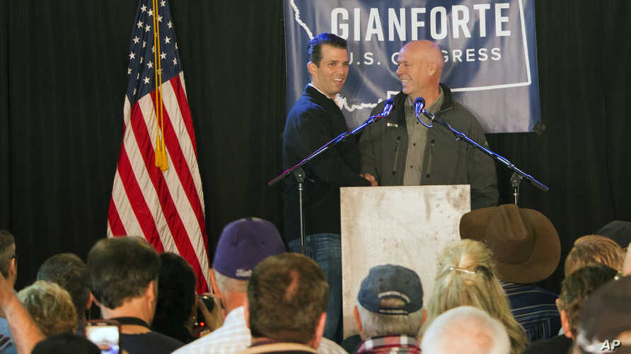 Republican Greg Gianforte (right) welcomes Donald Trump Jr. on to the stage at a rally in East Helena, Mont., May 11, 2017. Trump Jr. urged voters to support Gianforte in the May 25 special U.S. House election to fill the seat of Ryan Zinke, now Pres...