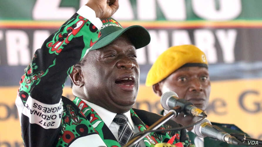 FILE - Zimbabwe's President Emmerson Mnangagwa (R) is seen at a ZANU-PF congress where he was said to still be consulting on senior party appointments, in Harare, Dec. 15, 2017. (S. Mhofu/VOA)