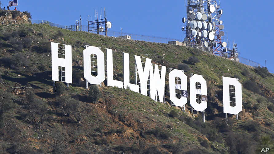 """The Hollywood sign in Los Angeles, California, is seen altered Jan. 1, 2017. Los Angeles residents awoke New Year's Day to find a prankster had changed the landmark sign to read """"HOLLYWEED."""""""
