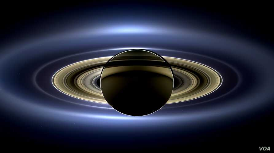 On July 19, 2013, in an event celebrated the world over, NASA's Cassini spacecraft slipped into Saturn's shadow and turned to image the planet, seven of its moons, its inner rings -- and, in the background, our home planet, Earth.
