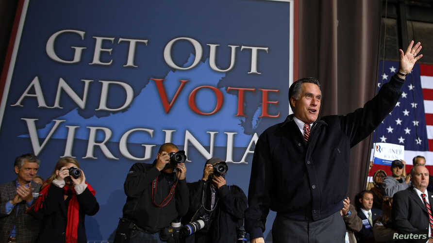 Republican presidential nominee Mitt Romney waves to the crowd at the conclusion of a campaign rally in Virginia Beach, Virginia, November 1, 2012.