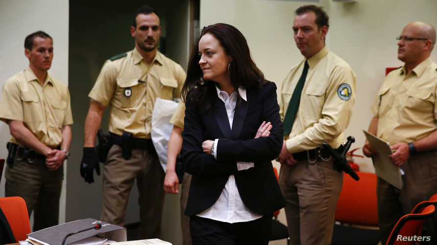 Beate Zschaepe, a member of the neo-Nazi group National Socialist Underground (NSU) stands in the court before the start of her trial in Munich, May 6, 2013.
