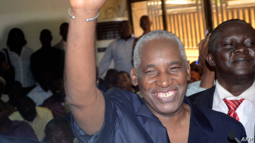 The Guinea Electoral Commission's newly elected president Bakary Fofana waves moments after being elected on November 1, 2012 in Conakry.