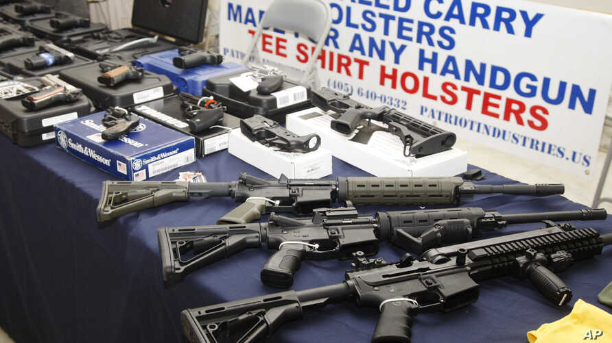 Guns are displayed during a rally at the state Capitol in Oklahoma City, Oklahama, May 8, 2012.