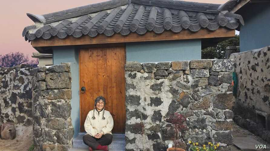 """Brenda Paik Sunoo, 70, relocated to Jeju in 2015. She and her husband built an house there and this month she published """"a love letter to Jeju,"""" """"Stone House on Jeju Island: Improvising Life Under a Healing Moon."""""""