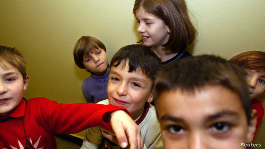 Chechen children play at a refugee centre in Moszno, near Poland's capital Warsaw, Sept. 20, 2004.