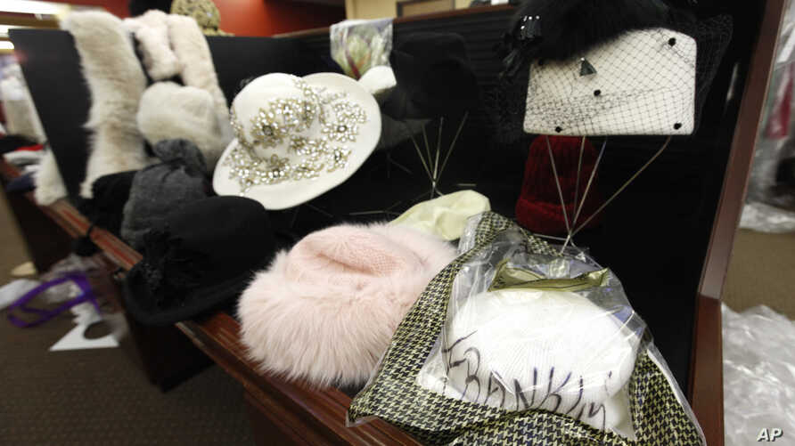 Hats and other items once owned by Aretha Franklin are shown for sale in Livonia, Michigan, Nov. 18, 2011. Follwing Franklin's death last month, some other of her former belongings will be auctioned off in New York in November.