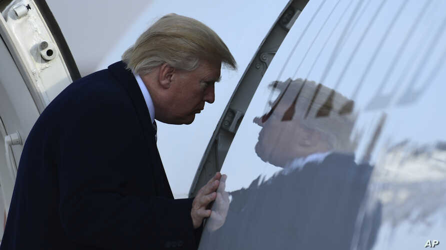 President Donald Trump walks up the steps of Air Force One at Andrews Air Force Base in Md., Saturday, Dec. 2, 2017. Trump is heading to New York to attend Republican fundraisers.