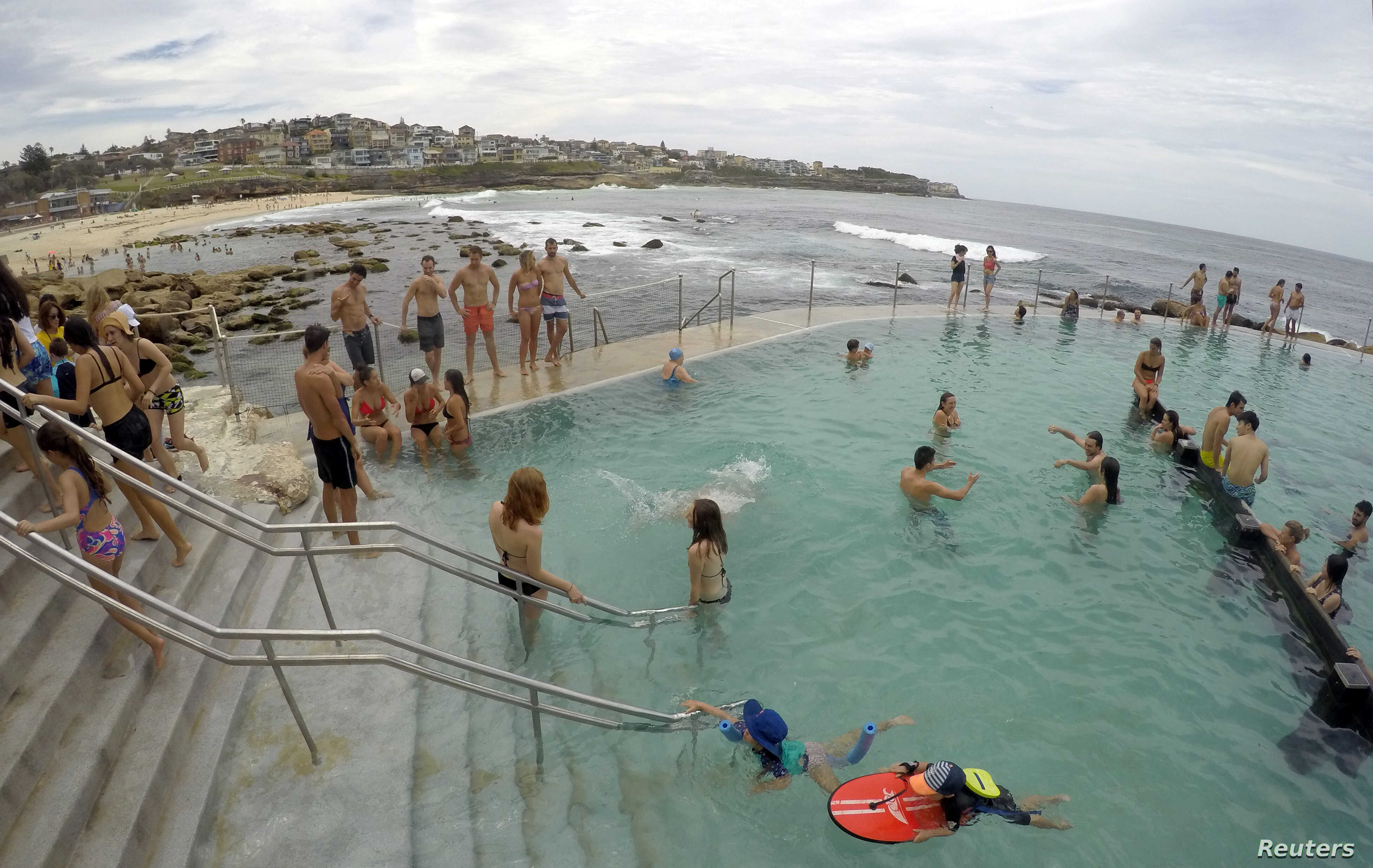 Swimmers cool off in a salt water ocean pool at Sydney's beachside suburb of Bronte, Dec. 14, 2016, to take relief from an early summer heat wave as the temperature in Sydney reached 37.1 degrees Celsius (100 Fahrenheit), according to the Australia's
