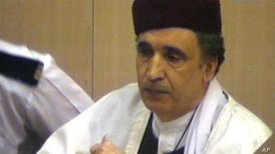FILe - Convicted Lockerbie bomber Abdel Basset  al-Megrahi, the only man ever convicted in the bombing of Pan Am flight 103 over Lockerbie, Scotland, listens as he is told the appeal of his conviction was turned down, at Camp Zeist, The Netherlands.