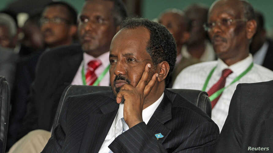 Somalia's newly elected President Hassan Sheikh Mohamud listens to proceedings after winning the election, in Mogadishu, September 10, 2012.