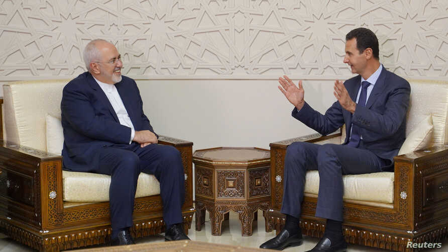 Syrian President Bashar al-Assad meets with Iran's Foreign Minister Mohammad Javad Zarif in Damascus, Syria, Sept. 3, 2018.