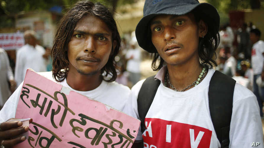 People affected with HIV participate in a protest rally to oppose a free trade agreement between India and European Union, in New Delhi, India ,  April 10, 2013.