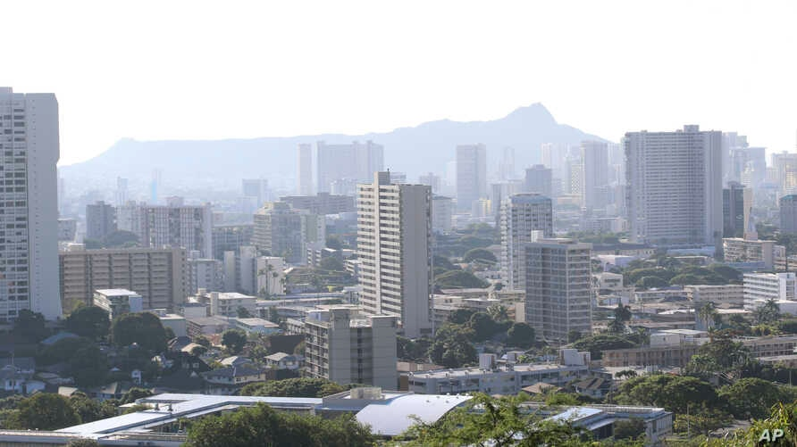 Diamond Head, an extinct volcanic crater, and high-rises are seen in Honolulu on Saturday, Jan. 13, 2018.