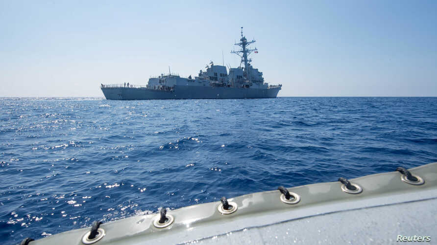 Arleigh Burke-class guided-missile destroyer USS Dewey transits the South China Sea