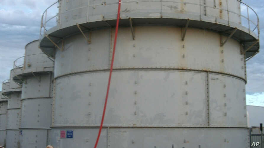 This photo released by Tokyo Electric Power Co. shows the storage tank that workers determined was overfilled, causing a leak of toxic water, Fukushima, Japan, Oct. 3, 2013.