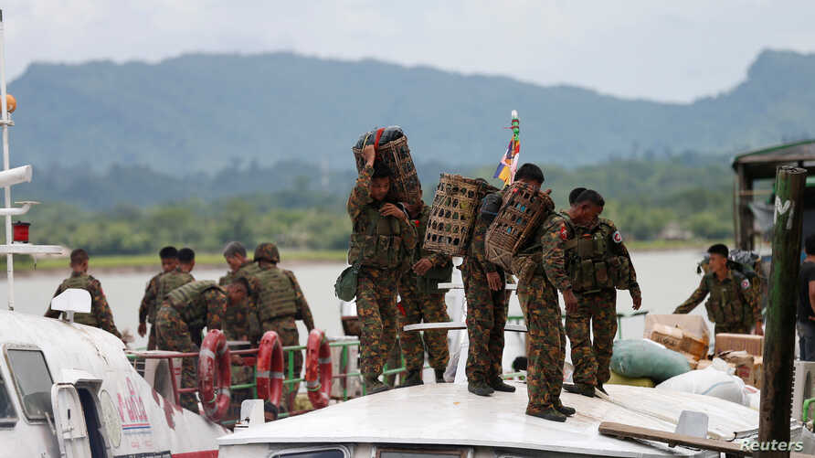FILE - Myanmar soldiers arrive to Buthidaung jetty after Arakan Rohingya Salvation Army's (ARSA) attacks, at Buthidaung, Myanmar, Aug. 29, 2017.