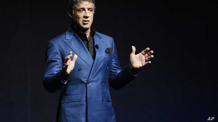 """FILE - Sylvester Stallone introduces a clip from the film """"Creed"""" at the Warner Bros presentation during CinemaCon 2015, at Caesars Palace, in Las Vegas, April 21, 2015."""