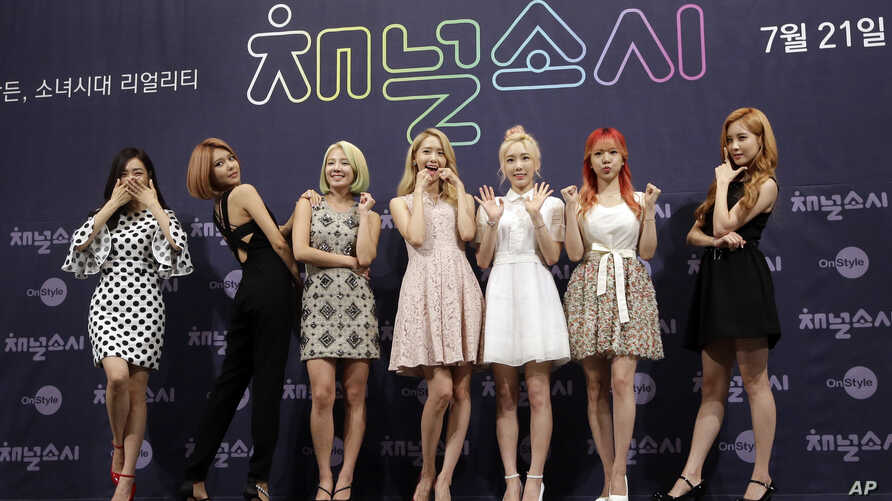 """Members of the South Korean girl group Girls' Generation pose for the media during a presentation to promote their new reality TV program """"Channel Girls' Generation"""" in Seoul, South Korea, July 21, 2015."""