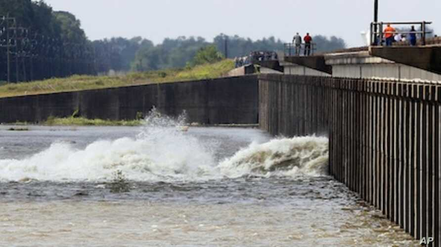 Water diverted from the Mississippi River spills through a bay in the Morganza Spillway in Morganza, La., Saturday, May 14, 2011.