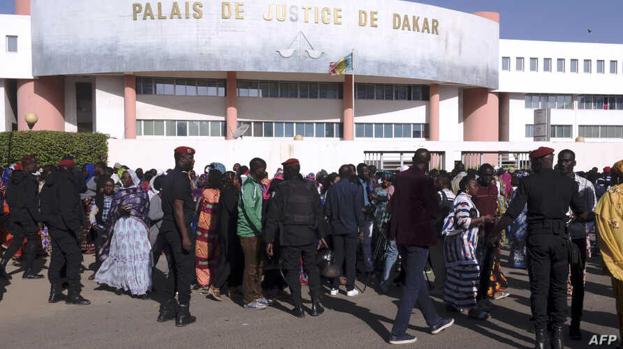 FILE - People queue to enter the Court in Dakar on Dec. 14, 2017, to attend the trial of Dakar's popular mayor Khalifa Sall and four of his associates on charges of embezzling public funds.