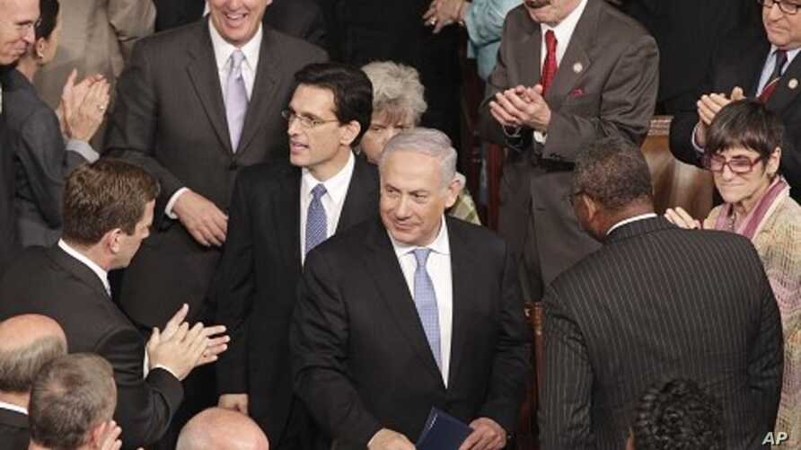 Israeli PM Benjamin Netanyahu, followed by House Majority Leader Eric Cantor, and House Majority Whip Kevin McCarthy arrives to address a joint meeting of Congress, on Capitol Hill in Washington, May 24, 2011