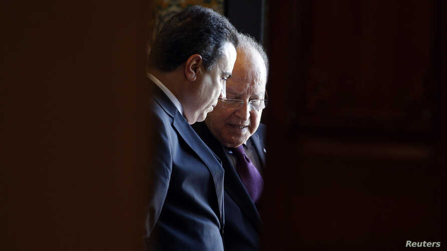 Tunisian Prime Minister Mehdi Jomaa (L) speaks with President of the Constituent Assembly Mustapha Ben Jaafar during a meeting in Tunis, Tunisia, May 1, 2014.