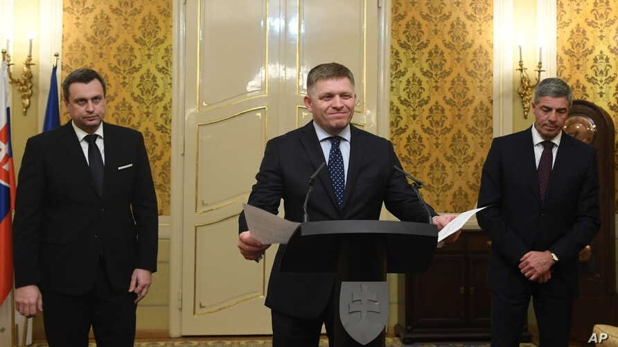 Slovak Prime Minister Robert Fico, center, Slovak National Party chairman Andrej Danko, left, and Most-Hid Chairman Bela Bugar  attend a press conference after a coalition council in Bratislava, Slovakia, March 14, 2018.