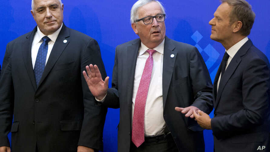(L-R) Bulgarian Prime Minister Boyko Borissov, European Commission President Jean-Claude Juncker and European Council President Donald Tusk take their places prior to a media conference at the conclusion of an EU and Western Balkan heads of state sum