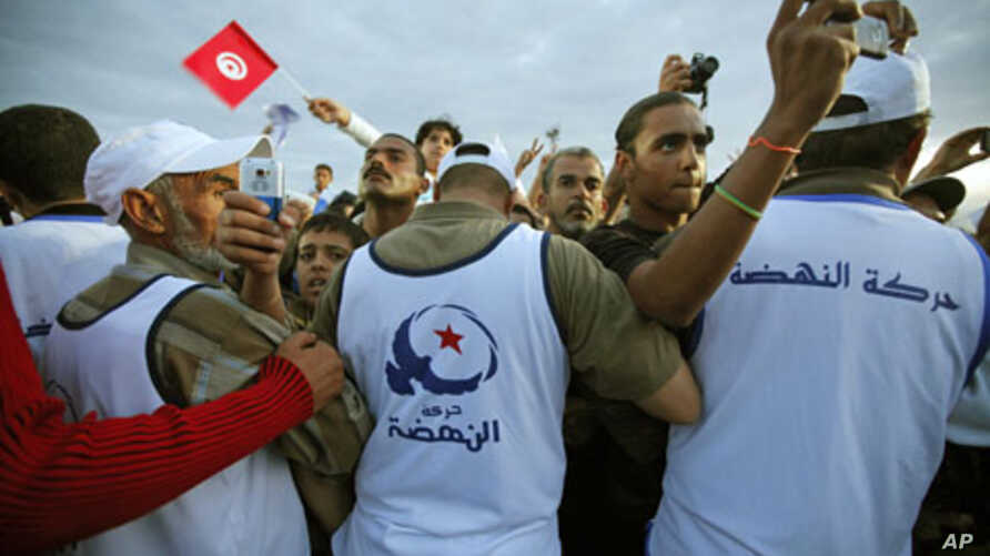 Supporters of the Islamist Ennahda movement attend a closing campaign rally in Tunis, Tunisia, October 21, 2011.
