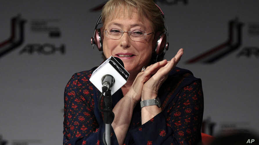 Former president Michelle Bachelet responds to a question during a presidential debate in Santiago, Chile, Oct. 25, 2013.