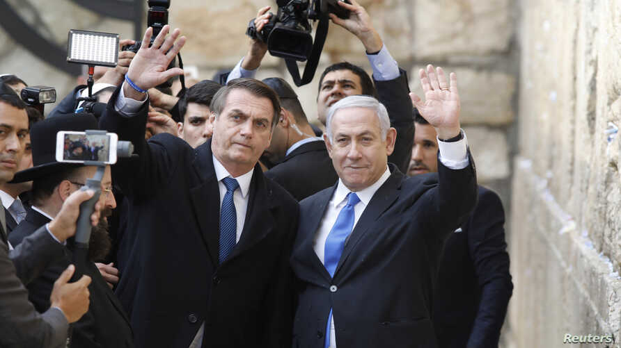 Brazilian President Jair Bolsonaro, accompanied by Israeli Prime Minister Benjamin Netanyahu, pose for a photo as they visit the Western Wall in Jerusalem's Old City, April 1, 2019.