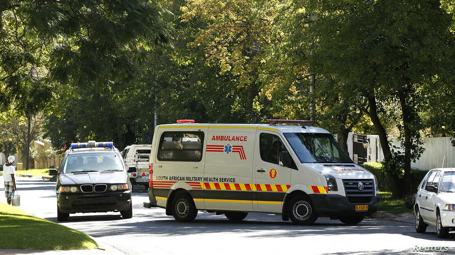 An ambulance believed to be transporting former South African president Nelson Mandela arrives at his house in Houghton, April 6, 2013.