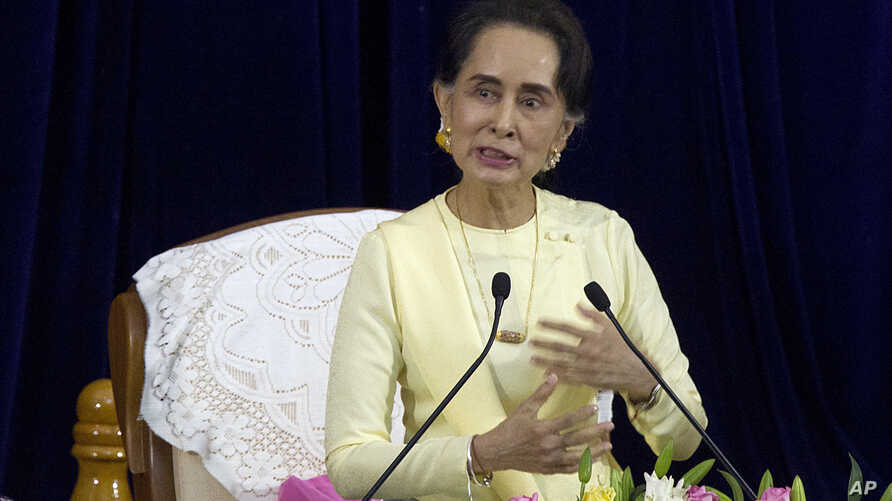 Myanmar leader Aung San Suu Kyi speaks during literacy talks with university students at the convocation hall of Yangon university Tuesday, Aug. 28, 2018, in Yangon, Myanmar.
