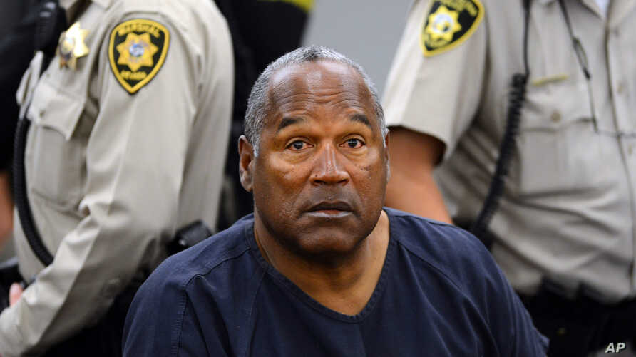 FILE - In this May 14, 2013, file photo, O.J. Simpson sits during a break o