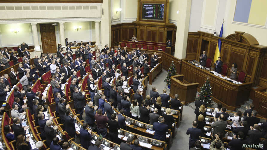 "Parliamentary deputies applaud after a renouncing of Ukraine's ""non-aligned"" status during a session of a parliament in Kyiv, Dec. 23, 2014."